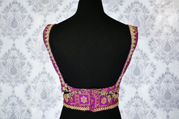 Buy purple embroidered sleeveless saree blouse online in USA. Pure Elegance Indian clothing store brings an exquisite range of readymade saree blouses in USA to match your gorgeous Indian saris. Add spark to your ethnic look with stylish sari blouses for weddings and parties.-back