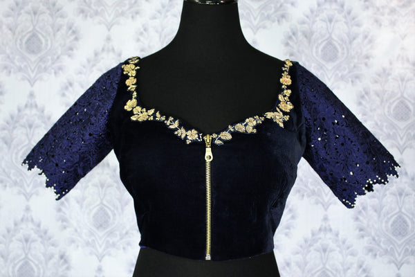 Buy navy blue embroidered velvet saree blouse online in USA. Pure Elegance Indian clothing store brings an exquisite range of readymade saree blouses in USA to match your gorgeous Indian sarees. Elevate your ethnic look with stylish sari blouses for weddings and parties.-front