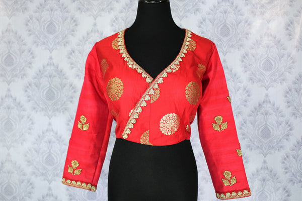 Buy ethnic red embroidered Banarasi saree blouse online in USA. Pure Elegance Indian clothing store brings an exquisite range of readymade saree blouses in USA to match your gorgeous Indian sarees. Elevate your ethnic look with stylish Indian sari blouses for weddings and parties.-front