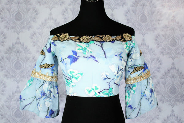 Buy blue printed and embroidered off shoulder sari blouse online in USA. Pure Elegance Indian fashion store brings an exclusively curated range of designer saree blouses in USA to match your gorgeous Indian saris. Glam up your Indian look with stylish Indian saree blouses for weddings and parties.-front