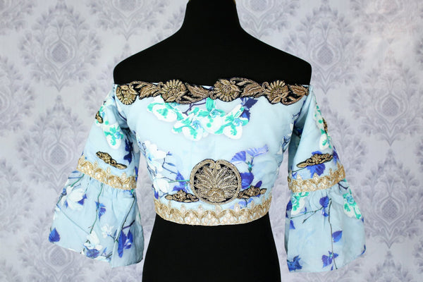 Buy blue printed and embroidered off shoulder sari blouse online in USA. Pure Elegance Indian fashion store brings an exclusively curated range of designer saree blouses in USA to match your gorgeous Indian saris. Glam up your Indian look with stylish Indian saree blouses for weddings and parties.-back