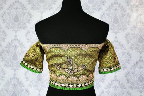 Buy green embroidered off shoulder saree blouse online in USA. Pure Elegance Indian fashion store brings an exclusively curated range of designer sari blouses in USA to match your gorgeous Indian sarees. Glam up your Indian look with stylish Indian saree blouses for weddings and parties.-back