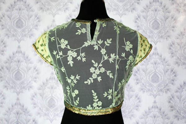 Buy green printed embroidered saree blouse with sheer back online in USA. Pure Elegance Indian fashion store brings an exclusively curated range of designer sari blouses in USA to match your gorgeous Indian sarees.-back