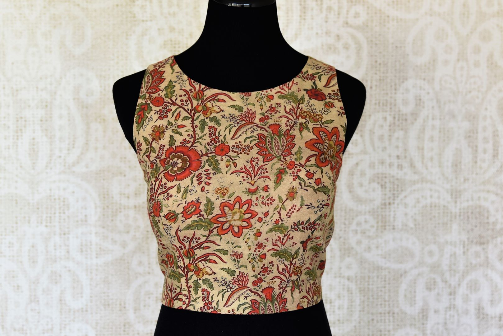 Buy beige printed sleeveless cotton saree blouse online in USA. Elevate your traditional Indian sarees with matching and contrasting saree blouses from Pure Elegance Indian clothing store in USA.-front