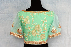 Buy pastel green thread embroidery readymade silk saree blouse online in USA. The blouse is a perfect match to add brightness to your Indian sarees. Shop beautiful Indian designer sari blouse in USA from Pure Elegance exclusive Indian clothing store in USA or shop online.-back