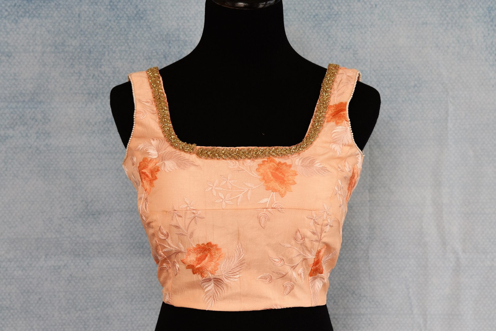 Shop peach thread embroidery silk sleeveless saree blouse online in USA. The blouse is a perfect match to add brightness to your Indian sarees. Shop beautiful Indian designer saree blouses in USA from Pure Elegance exclusive Indian clothing store in USA or shop online.-full view