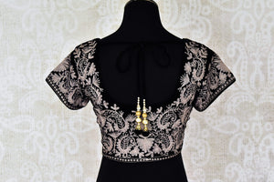 Shop black velvet embroidered saree blouse online in USA. Pure Elegance Indian clothing store brings a stylish range of designer saree blouses in USA. You can also shop online and enjoy speedy delivery at your doorsteps. Shop now.-back