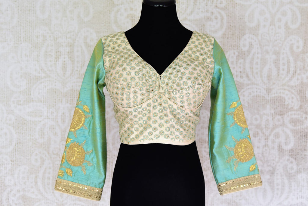 Shop off white embroidered silk saree blouse online in USA with green sleeves . Pure Elegance Indian clothing store brings a stylish range of designer sari blouses in USA. You can also shop online and enjoy speedy delivery at your doorsteps. Shop now.-front