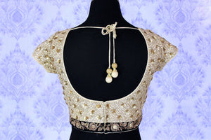 Flaunt the graceful diva in you as you slip into the jazzy golden embroidered floral sequin designer saree blouse. Take this ecstatic blouse to parties, special occasions, festivals and weddings. Shop such beautiful Indian designer blouses online or visit Pure Elegance store-back