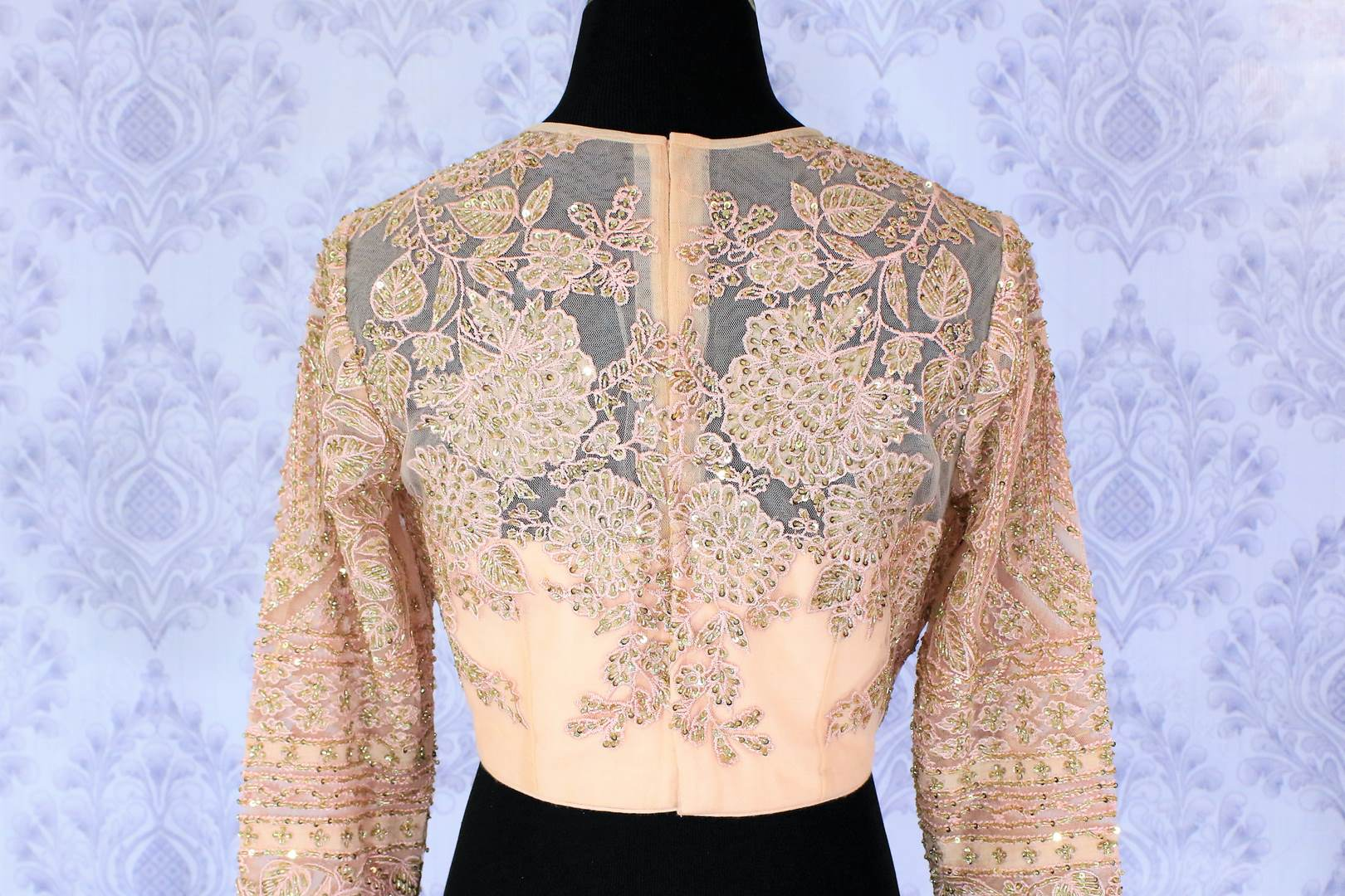 Sizzle like a princess in our exquisitely designed blush pink designer saree blouse with floral embroidery sheer net full sleeve details. The intricately handcrafted modern blouse is your go-to wedding and party must-have. Shop beautiful designer blouses online or visit Pure Elegance store in USA. -back