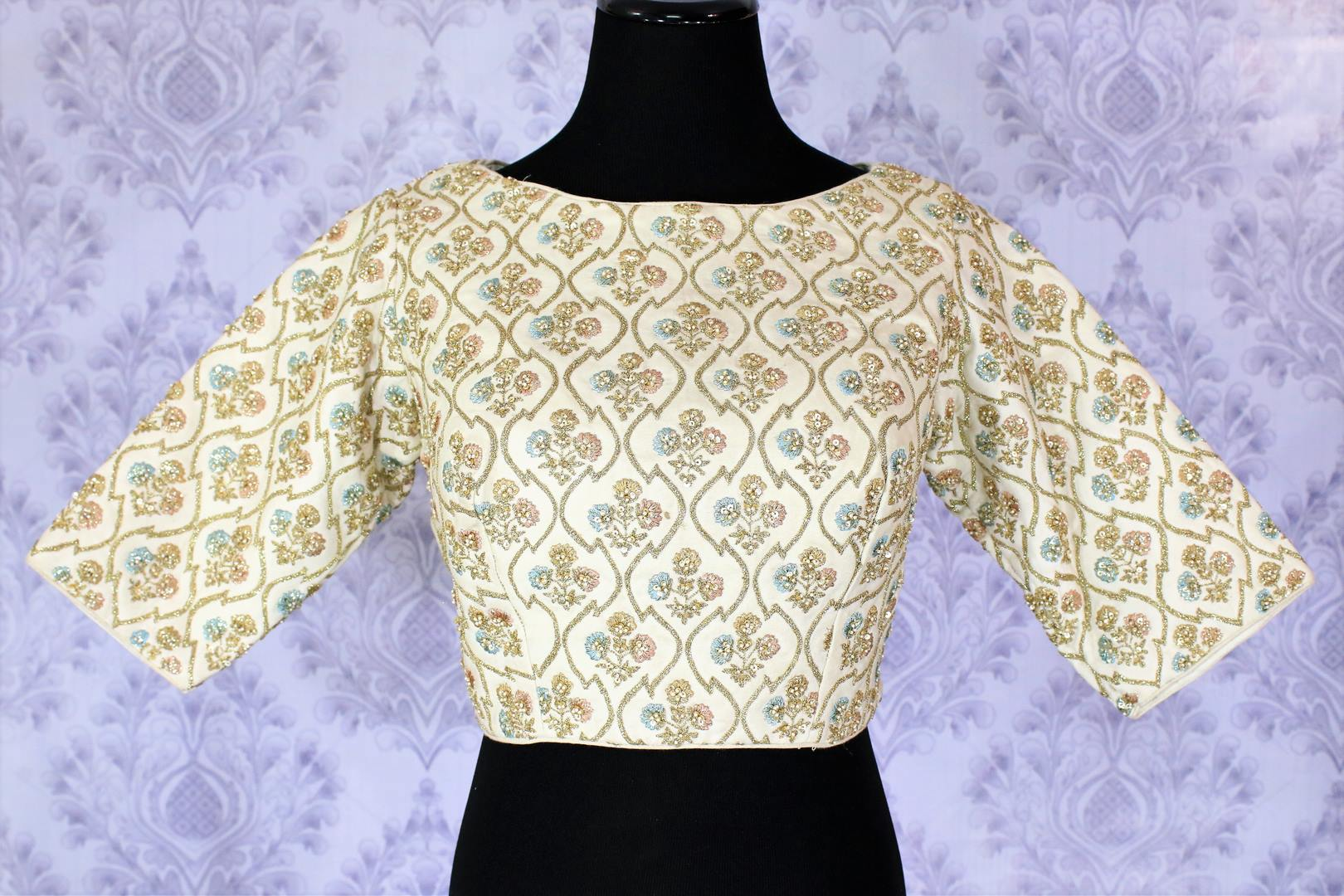 The sophisticated yet suave white embroidered designer blouse. The boat neck party blouse is a versatile piece of garment in your wardrobe, team it up with lehenga skirts, maxi skirts or even the palazzo pants for an Indo-fusion look. Shop beautiful designer blouses online or visit Pure Elegance store in USA. -front
