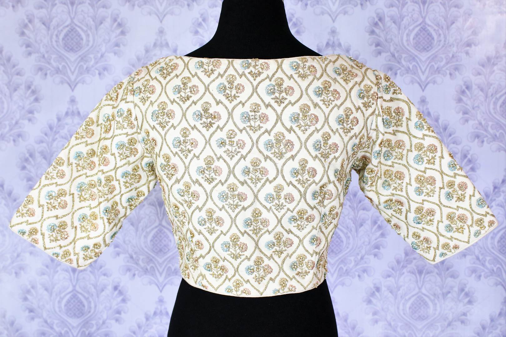 The sophisticated yet suave white embroidered designer blouse. The boat neck party blouse is a versatile piece of garment in your wardrobe, team it up with lehenga skirts, maxi skirts or even the palazzo pants for an Indo-fusion look. Shop beautiful designer blouses online or visit Pure Elegance store in USA. -back