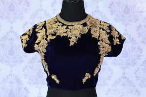 Embrace the beauty of celebrity-inspired royal blue velvet embroidered blouse with intricate detailing. The floral embroidered velvet blouse has a deep oval back that will totally leave everyone in awe. Strike a lasting impression in this designer blouse, shop online or visit Pure Elegance store in USA.-front