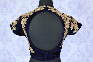 Embrace the beauty of celebrity-inspired royal blue velvet embroidered blouse with intricate detailing. The floral embroidered velvet blouse has a deep oval back that will totally leave everyone in awe. Strike a lasting impression in this designer blouse, shop online or visit Pure Elegance store in USA.-back