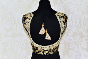 Buy black Banarasi embroidered sleeveless saree blouse online in USA . Pure Elegance Indian clothing store brings a stylish range of designer saree blouses in USA. You can also shop online and enjoy speedy delivery at your doorsteps. Shop now.-back