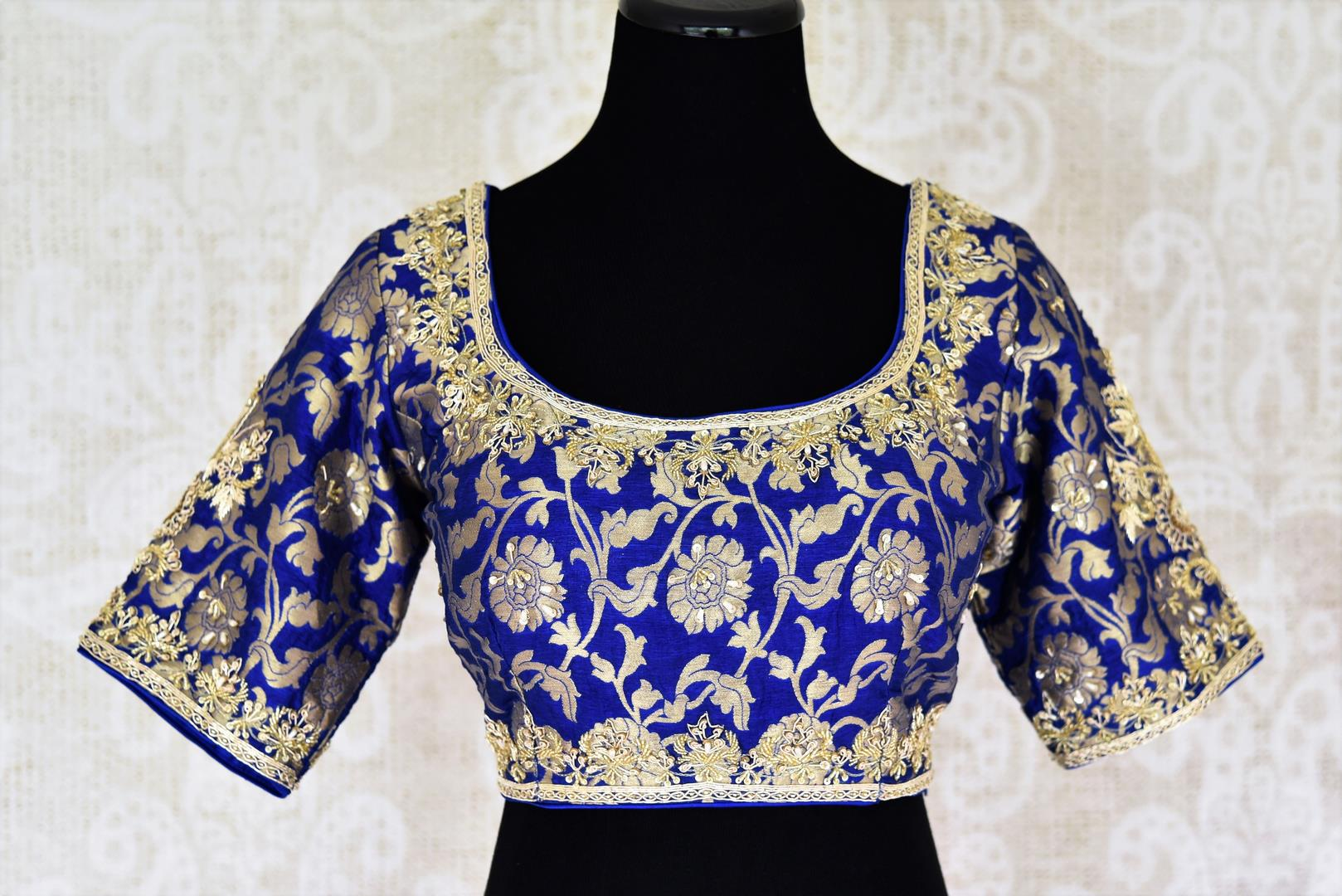 Buy beautiful blue Banarasi embroidered readymade saree blouse online in USA. Match your saree with exquisite designer saree blouses from Pure Elegance clothing store in USA. Shop now at our store or visit online.-front