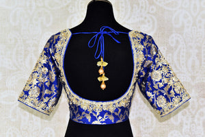 Buy beautiful blue Banarasi embroidered readymade saree blouse online in USA. Match your saree with exquisite designer saree blouses from Pure Elegance clothing store in USA. Shop now at our store or visit online.-back
