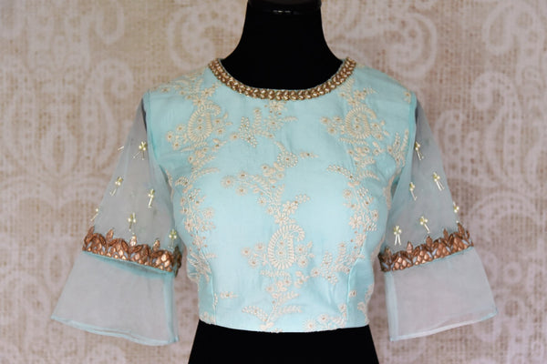 Buy pastel blue silk embroidered saree blouse online in USA. Match your saree with exquisite designer sari blouses from Pure Elegance clothing store in USA. Shop now at our store or visit online.-front