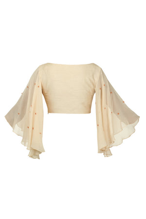 Buy beige raw silk angle sleeved blouse online in USA with shoulder embroidery. Match your designer sarees with stylish Indian readymade saree blouses available at Pure Elegance clothing store in USA or shop online.-back