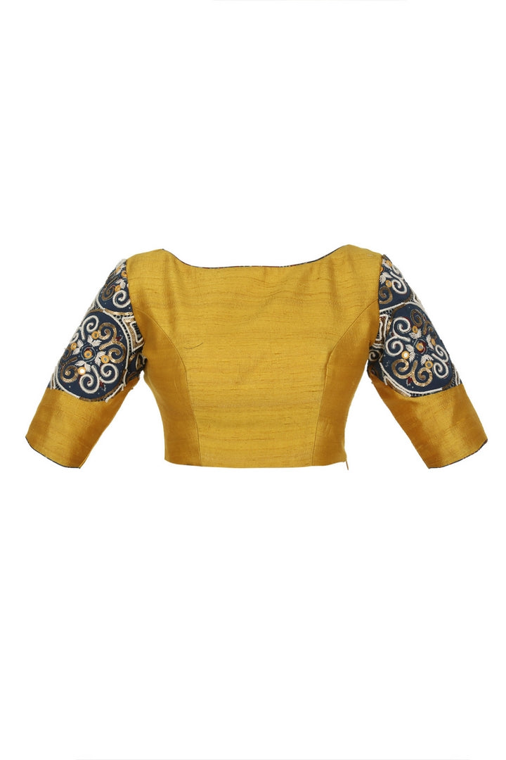 Buy mustard yellow raw silk designer saree blouse online in USA with ajrak applique. Match your designer sarees with stylish Indian readymade saree blouses available at Pure Elegance clothing store in USA or shop online.-front