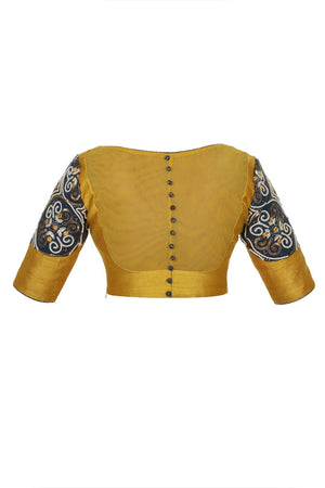 Buy mustard yellow raw silk designer saree blouse online in USA with ajrak applique. Match your designer sarees with stylish Indian readymade saree blouses available at Pure Elegance clothing store in USA or shop online.-back
