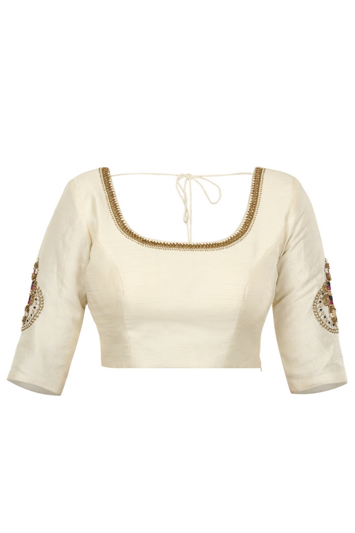 Buy off-white raw silk saree blouse with embroidered sleeves online in USA. Match your designer sarees with stylish readymade saree blouses available at Pure Elegance clothing store in USA or shop online.-front