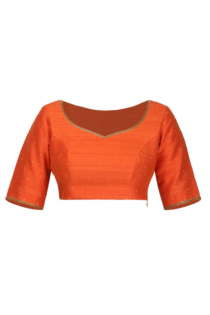 Buy orange raw silk saree blouse online in USA with hand embroidery. Match your designer sarees with stylish readymade sari blouses available at Pure Elegance clothing store in USA or shop online.-front