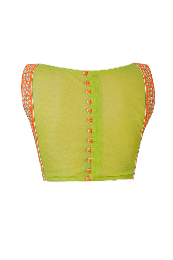 Buy orange boat neck raw silk saree blouse online in USA with kundan embroidery. Take your saree style a level up with beautiful designer saree blouses from Pure Elegance Indian fashion store in USA. You can also shop Indian clothing online from our online shopping website.-back