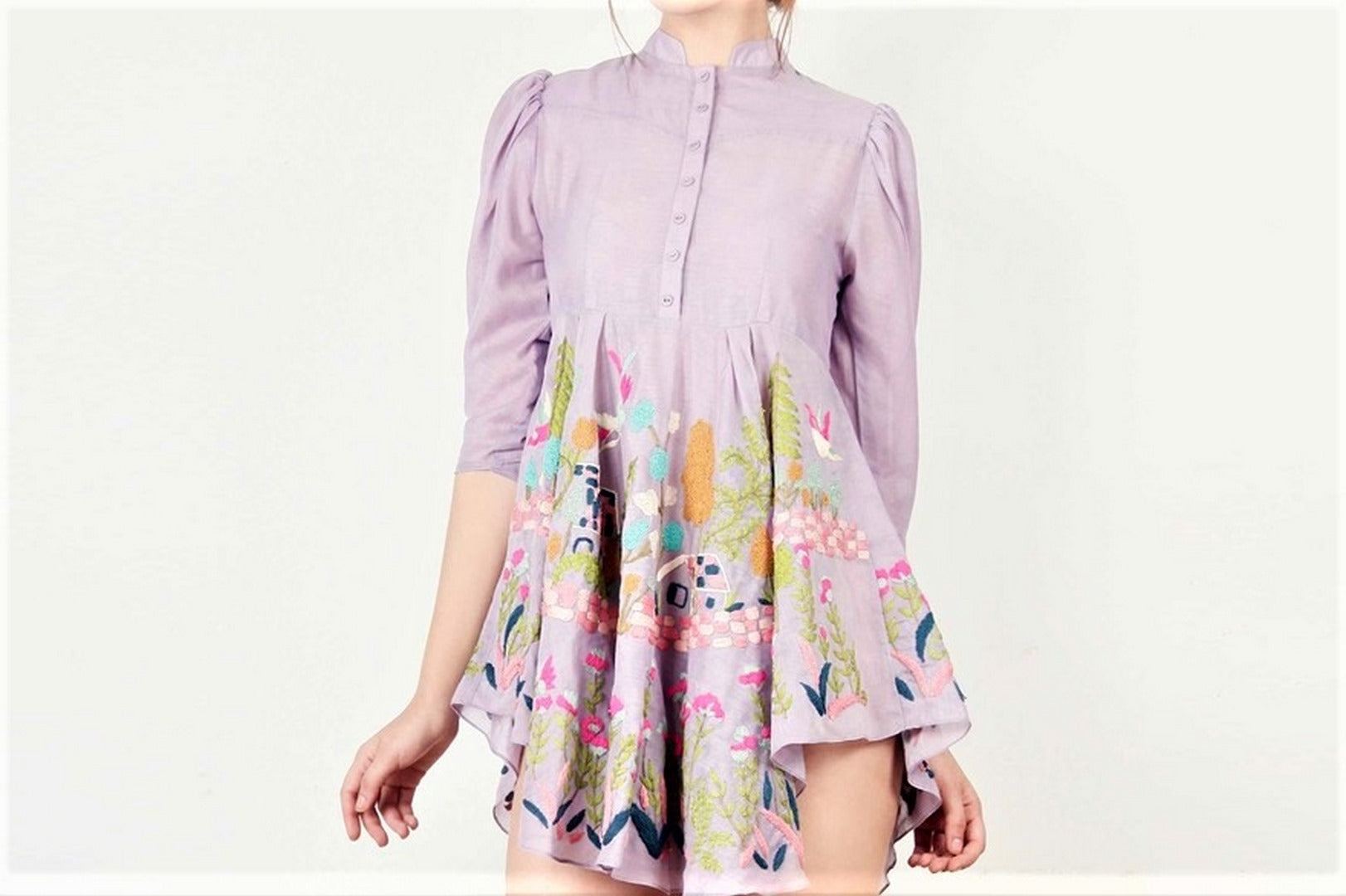 Buy stylish plum house story embroidered flared dress online in USA with puff sleeves. Bring a glamorous touch to your look in fashionable designer dresses, gowns, Indowestern dresses from Pure Elegance clothing store in USA or shop online.-details