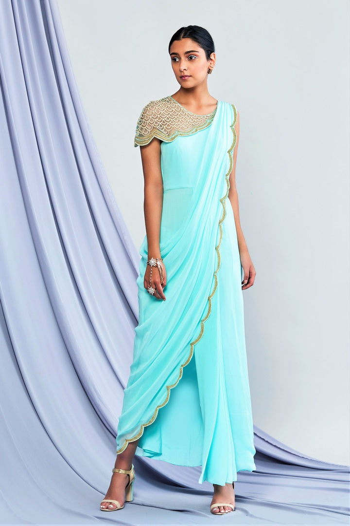 Buy designer turquoise blue georgette draped saree online in USA. Elevate your Indian style with a range of exclusive Indian designer dresses from Pure Elegance clothing store in USA. We have an exquisite collection of Indian sarees, suits, Anarkalis, lehengas for Indian women living in USA. Shop now.-full view