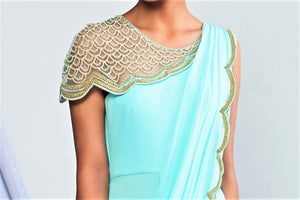 Buy designer turquoise blue georgette draped saree online in USA. Elevate your Indian style with a range of exclusive Indian designer dresses from Pure Elegance clothing store in USA. We have an exquisite collection of Indian sarees, suits, Anarkalis, lehengas for Indian women living in USA. Shop now.-top