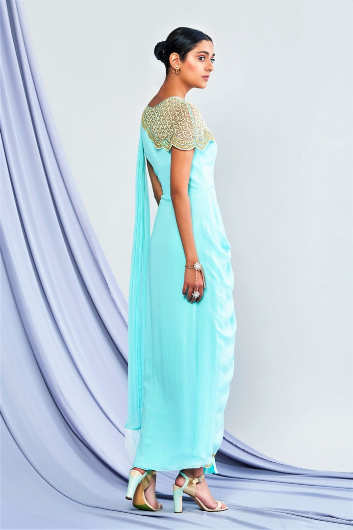 Buy designer turquoise blue georgette draped saree online in USA. Elevate your Indian style with a range of exclusive Indian designer dresses from Pure Elegance clothing store in USA. We have an exquisite collection of Indian sarees, suits, Anarkalis, lehengas for Indian women living in USA. Shop now.-back