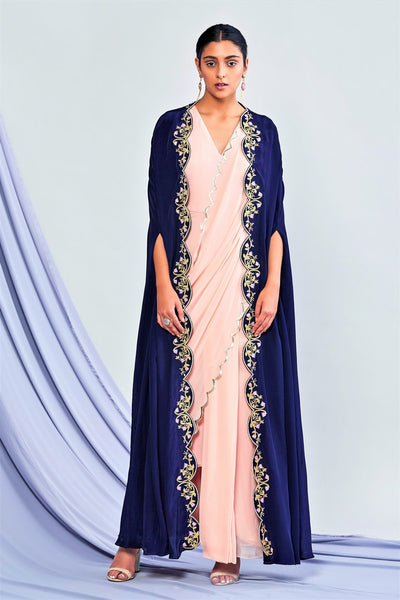 Buy blush pink draped saree with navy blue embroidered cape online in USA. Elevate your Indian style with a range of exclusive Indian designer dresses from Pure Elegance clothing store in USA. We have an exquisite collection of Indian sarees, suits, Anarkalis, lehengas for Indian women living in USA. Shop now.-full view