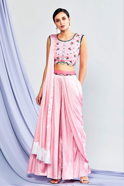 Shop pink draped palazzo saree with printed blouse online in USA. Elevate your Indian style with a range of exclusive Indian designer outfits from Pure Elegance clothing store in USA. We have an exquisite collection of Indian saris, suits, Anarkalis, lehengas for Indian women living in USA. Shop now. -full view