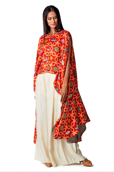 Buy bundi scarlet jaal printed cape with white pleated pants online in USA. Find a range of stunning designer dresses by Swati Vijaivargie in USA at Pure Elegance Indian clothing store. Elevate your traditional style with a range of designer silk sarees, Indian clothing, and much more also available at our online store.-full view