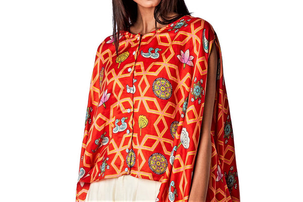 Buy bundi scarlet jaal printed cape with white pleated pants online in USA. Find a range of stunning designer dresses by Swati Vijaivargie in USA at Pure Elegance Indian clothing store. Elevate your traditional style with a range of designer silk sarees, Indian clothing, and much more also available at our online store.-top