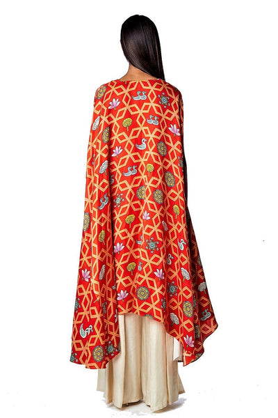 Buy bundi scarlet jaal printed cape with white pleated pants online in USA. Find a range of stunning designer dresses by Swati Vijaivargie in USA at Pure Elegance Indian clothing store. Elevate your traditional style with a range of designer silk sarees, Indian clothing, and much more also available at our online store.-back
