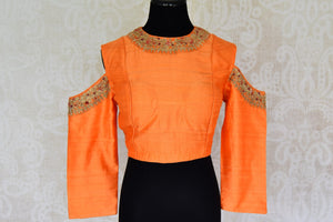 Buy orange color embroidered cold shoulder silk blouse online in USA. For Indian women in USA, Pure Elegance fashion store brings an alluring collection of readymade saree blouses to match your beautiful Indian sarees. Shop now at our online store.-front