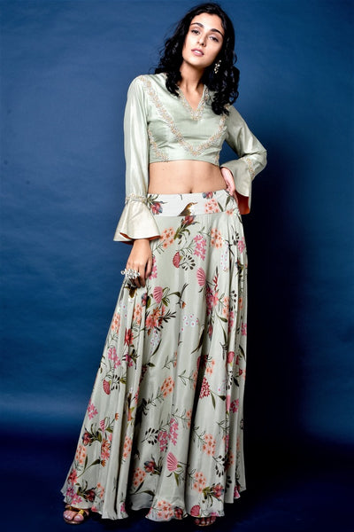 Shop sage green silk top with floral print flared skirt online in USA. Elevate your ethnic style with a stunning range of Indian dresses from Pure Elegance Indian fashion store in USA. You can also shop the same collection from our online store.-full view