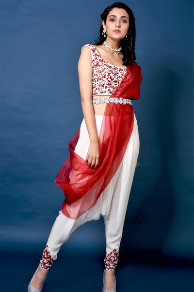 Buy red and cream thread work blouse with dhoti pants online in USA. Elevate your ethnic style with a stunning range of Indian designer dresses from Pure Elegance Indian fashion store in USA. You can also shop the same collection from our online store.-full view