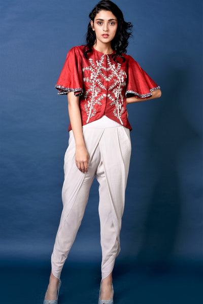 Buy red embroidered raw silk jacket with dhoti pants online in USA. Elevate your ethnic style with a stunning range of Indian designer dresses from Pure Elegance Indian fashion store in USA. You can also shop the same collection from our online store.-full view