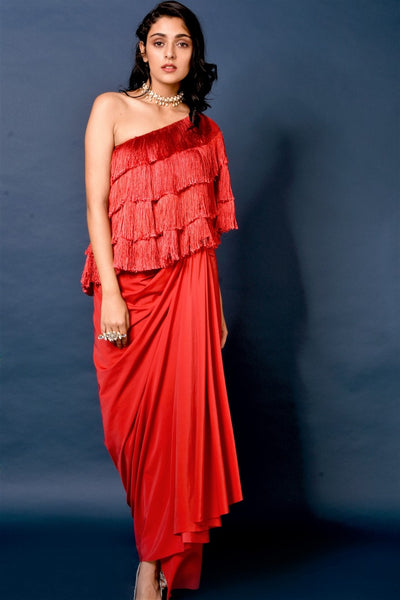 Shop red one-shoulder tassel cape with dhoti skirt online in USA. Elevate your ethnic style with a stunning range of Indian designer dresses from Pure Elegance Indian fashion store in USA. You can also shop the same collection from our online store.-full view