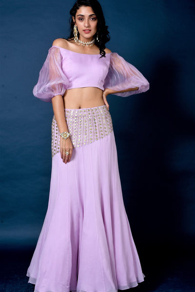 Buy lavender color organza top with mirror work skirt online in USA. Elevate your style with a stunning range of designer dresses, designer gowns, designer Anarkali suits from Pure Elegance Indian fashion store in USA. You can also shop the same collection from our online store.-full view