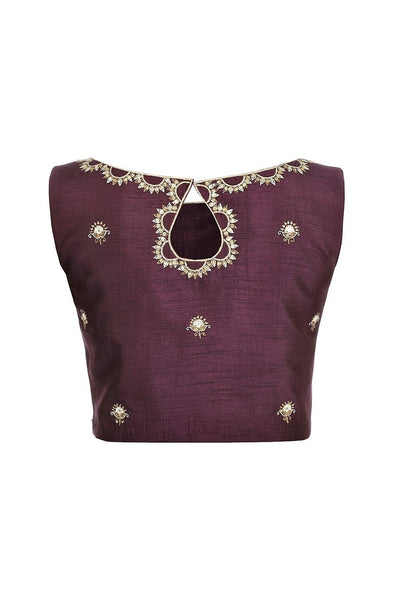 Buy purple sleeveless sari blouse with embroidery online in USA at Pure Elegance fashion store. Choose from a range of exquisite readymade designer sari blouses perfect to amp up your saree style. also available at our online store.-back
