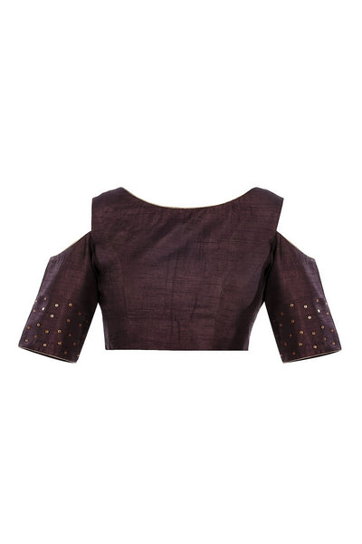 Buy burgundy color raw silk embroidered saree blouse with cold shoulder sleeves online in USA from Pure Elegance fashion store. Choose from a range of exquisite readymade designer sari blouses perfect to amp up your saree style. also available at our online store.-full view