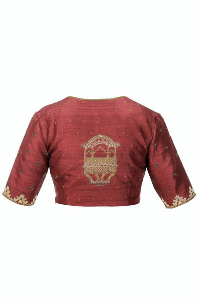 Buy burgundy color zardozi embroidery raw silk saree blouse online in USA from Pure Elegance fashion store. Choose from a range of exquisite readymade designer sari blouses perfect to amp up your saree style. also available at our online store.-back