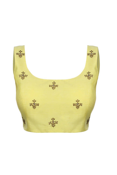 Buy pastel yellow embroidered sleeveless saree blouse with cut out back online in USA from Pure Elegance fashion store. Choose from a range of exquisite readymade saree blouses perfect to amp up your saree style. also available at our online store.-full view