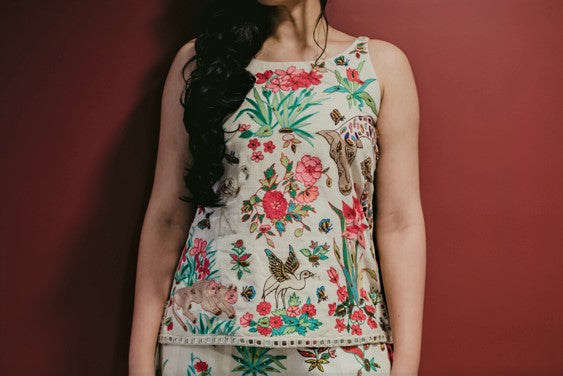 Buy off-white embroidered spaghetti top with flared palazzo online in USA. Pick your favorite Indian dresses from Pure Elegance clothing store in USA. Step up your style with a range of Indian designer dresses, suits, designer lehengas also available on our online store.-top