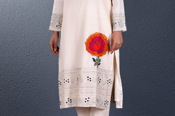 Buy off-white khadi hand embroidered kurta with slim pants online in USA. Pick your favorite Indian dresses from Pure Elegance clothing store in USA. Step up your style with a range of Indian designer dresses, suits, designer lehengas also available on our online store. -embroidery
