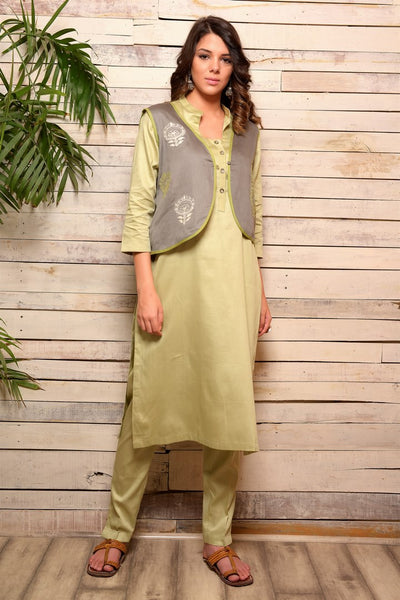 Buy tonal green cotton kurta with embroidered jacket online in USA and pants. Pick your favorite Indian designer suits and dresses from Pure Elegance clothing store in USA. Make your ethnic collection complete with a range of Indian sarees, Anarkali suits, designer lehengas also available on our online store.  -full view